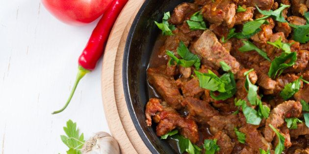 Chahohbili - traditional georgian beef stew served on black iron skillet with parsley, garlic, top