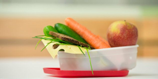 GOETTINGEN, GERMANY - SEPTEMBER 19: Healthy breakfast, lunchbox filled with wholewheat bread, fruit and...