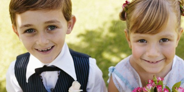 'Bridesmaid and pageboy(6-7) smiling, close-up,