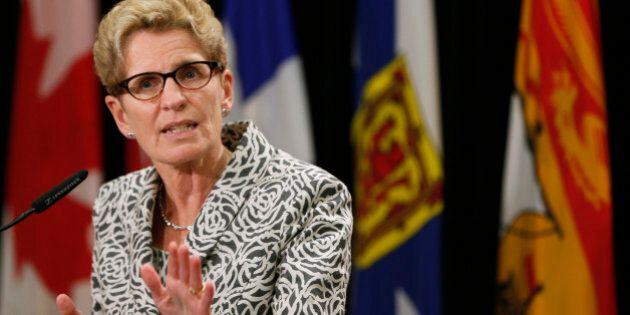 Ontario premier Kathleen Wynne speaks to the media during a news conference during the Council of the...