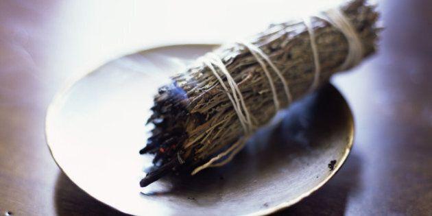 Burning sage bundle purifies