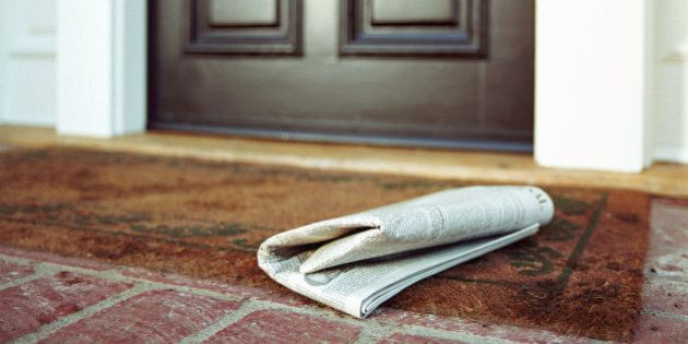 Newspaper on front step of
