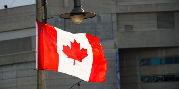 TORONTO, ONTARIO, CANADA - 2015/06/13: Canadian National flag waving in downtown Toronto.The National Flag of Canada, also known as the Maple Leaf and l'Unifolié . It is the first ever specified by statute law for use as the country's national flag. (Photo by Roberto Machado Noa/LightRocket via Getty Images)