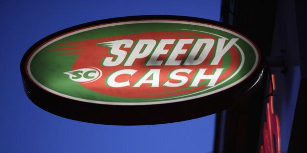 LONDON, ENGLAND - NOVEMBER 01: A sign outside a 'Speedy Cash' cash loans shop on Brixton High Street...