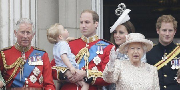 Britain's Prince William holds his son Prince George, with Queen Elizabeth II, 2nd right, Kate, Duchess...