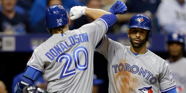 Toronto Blue Jays' Josh Donaldson (20) celebrates with on-deck batter Jose Bautista after hitting a home run off Tampa Bay Rays starting pitcher Drew Smyly during the fifth inning of a baseball game Monday, April 4, 2016, in St. Petersburg, Fla. (AP Photo/Chris O'Meara)