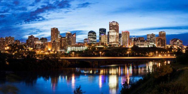 Panoramic view of Edmonton skyline reflected in North Saskatchewan River.