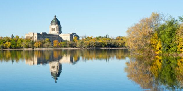 The Saskatchewan Legislative Building is reflected in Wascana Lake on a beautiful, sunny autumn morning...