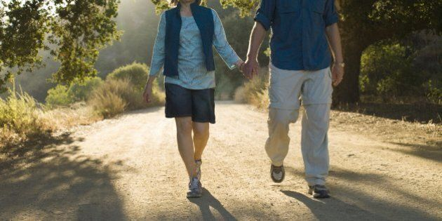 Mature couple walking down dirt
