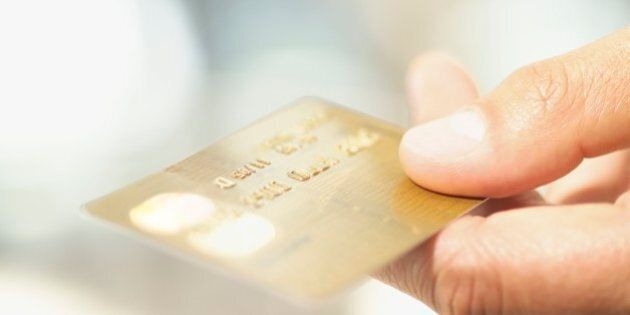 Close up of credit card in man's