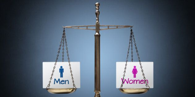 Equality between man and woman concept with beam scales and