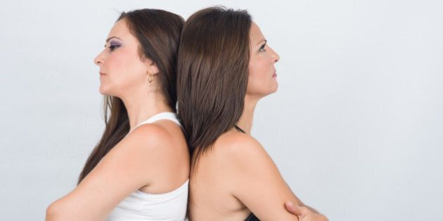 Two woman adult back to back with communication