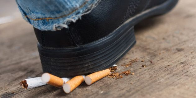 Man quit smoking and crush cigarettes