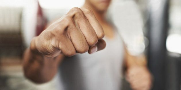 Shot of a young boxer throwing a