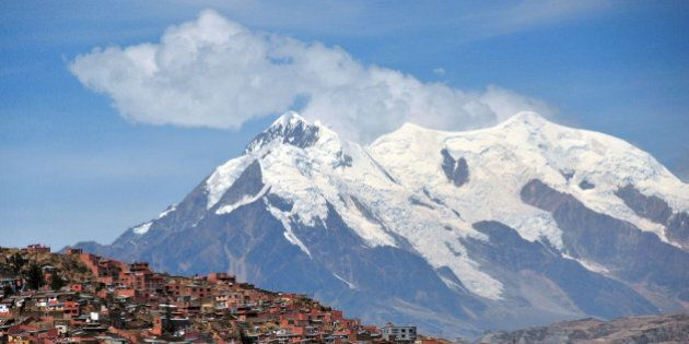 La Paz, Bolivia: southern suburbs and mount llimani - orogenic cloud formation - photo by