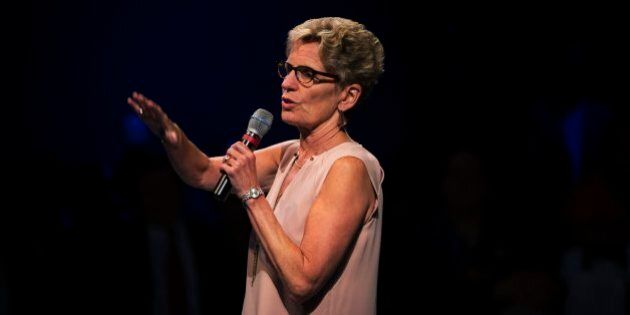 TORONTO, ON - JULY 14: Premier Kathleen Wynne addresses the crowd gathered for the anti-racism meeting...