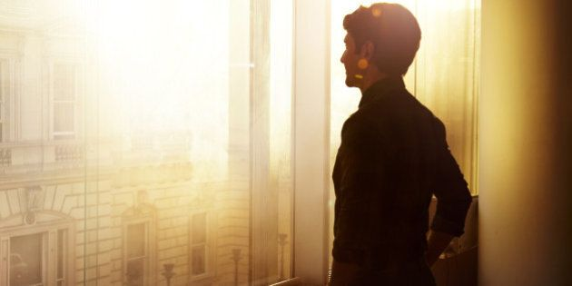 Businessman looking out over the city at