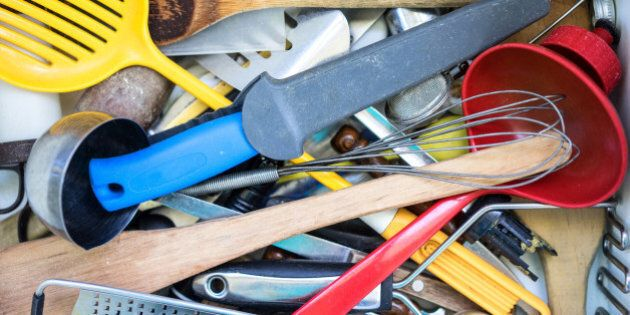 Untidy clutter of kitchen utensils in a