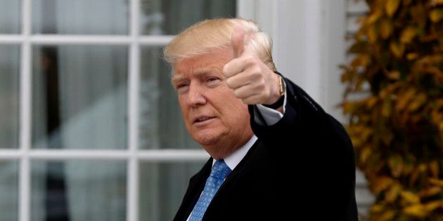 President-elect Donald Trump gives the thumbs up as he arrives at the Trump National Golf Club Bedminster clubhouse, Sunday, Nov. 20, 2016 in Bedminster, N.J.. (AP Photo/Carolyn Kaster)