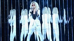 Katy Perry Rocks White Pantsuit, 'Persist' Armband At The
