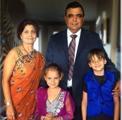 Deepak Obhrai is seen in an undated photo with his wife, and their grandkids Davin, 10, and Evasha,