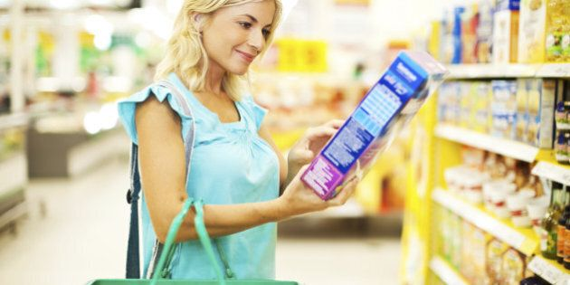 Young blonde woman shopping cereals in the
