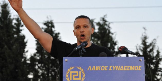 THERMOPYLAE, GREECE - SEPTEMBER 03:  Ilias Kassidiaris, lawmaker of the Golden Dawn party, addresses supporters in front of the King Leonidas monument during the event to commemorate the fallen of the battle of Thermopylae on September 3, 2016 in Thermopylae, Greece. (Photo by Nicolas Koutsokostas/Cobis via Getty Images)