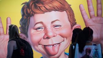 SAN DIEGO, CA - JULY 20: The face of Alfred E. Neuman frames greets attendees at the DC booth during the first day of Comic-Con International at the San Diego Convention Center in San Diego, CA on Thursday, July 20, 2017. (Photo by Kevin Sullivan/Digital First Media/Orange County Register via Getty Images)