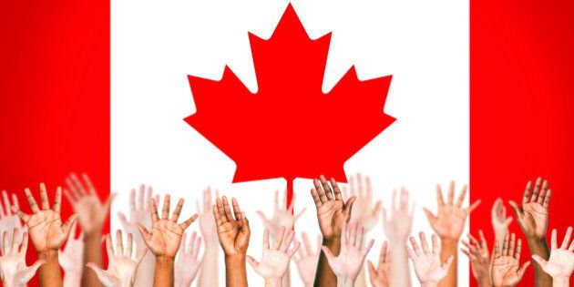 Multi-Ethnic Hands With Flag Of Canada For The Background.
