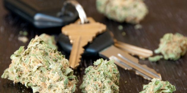 Marijuana lying on a table next to car keys.