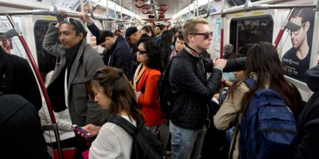 TORONTO, ON - OCTOBER 7: TTC riders aboard the Yonge subway line for Toronto Star story on election issues....