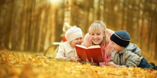 Mother reading book for