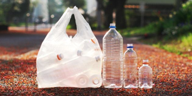 A bag of PET bottle and three loose PET bottles ready to be taken to recycle