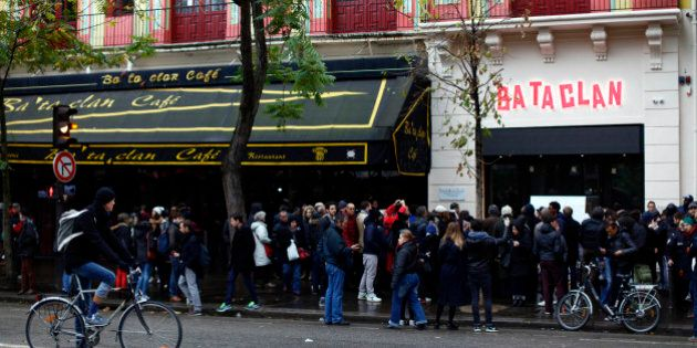 People gather in front of the Bataclan concert hall as France commemorates one year since the Paris terrorist attacks on November 13, 2016 in Paris, France. France pay tributes to the victims of the 2015 Paris terrorists attacks which left at least 130 dead and many others injured by gunmen and suicide bombers from the Islamic State. (Photo by Mehdi Taamallah/NurPhoto via Getty Images)