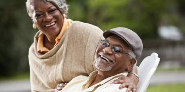 Portrait of stylish senior African American couple. Focus on man