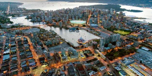 Canada, BC, Vancouver.  Aerial view of downtown Vancouver at dusk. False Creek in foreground.