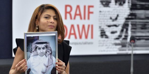 TOPSHOT - Ensaf Haidar holds a picture of her husband Raif Badawi after accepting the European Parliament's...