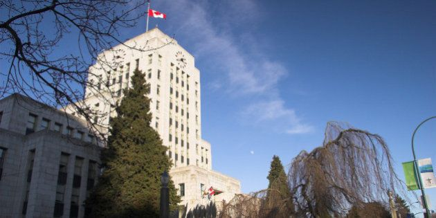 Vancouver City Hall landscape with canada Flag on clear winter day - Vancouver