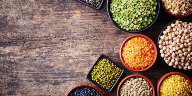 Bowls of various legumes (chickpeas, green peas, red lentils, canadian lentils, indian lentils, black...