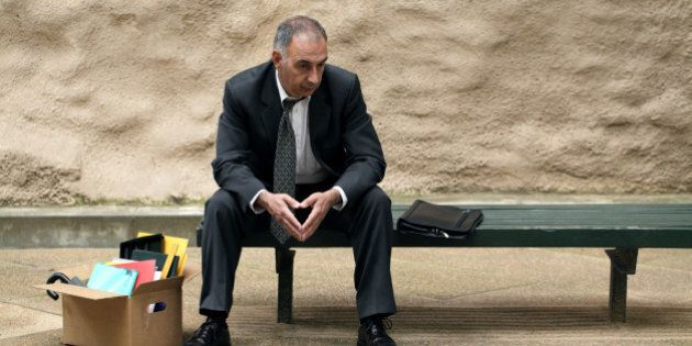 Retrenched manager sits on bench and ponders his future