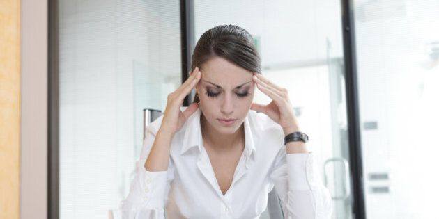 Overworking business woman suffering from