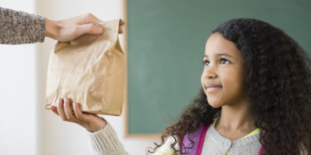 Student taking brown bag lunch in
