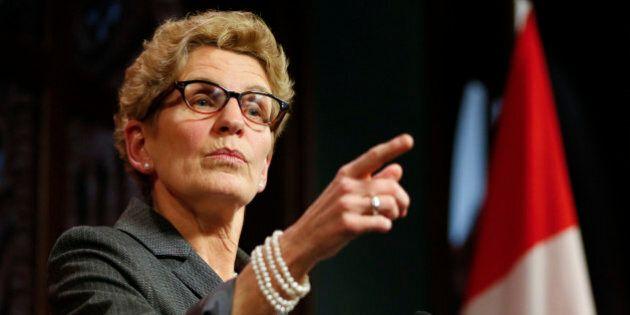 TORONTO, ON - MARCH 26: Premier Kathleen Wynne responds to breach of trust allegations made by Tim Hudak...