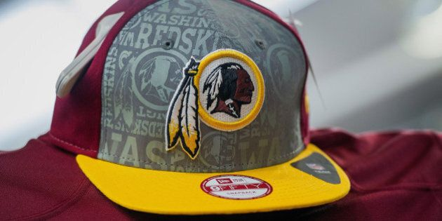 The Washington Redskins football team logo is displayed on a hat for sale at a store in San Francisco, California, U.S., on Wednesday, June 18, 2014. The Washington Redskins lost a trademark decision after a federal agency ruled the team's name disparaged Native Americans, threatening millions of dollars in sales of everything from football jerseys to beer coolers. Photographer: David Paul Morris/Bloomberg via Getty Images