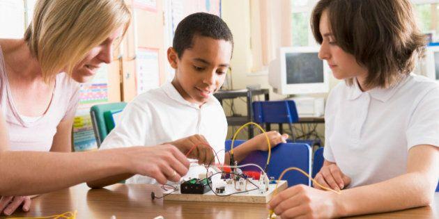Schoolchildren and their teacher in a science