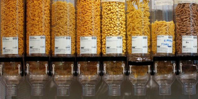 Containers with pasta is displayed at the Original Unverpackt (Original Unpacked) zero-waste grocery store in Berlin's Kreuzberg district September 16, 2014. Original Unverpackt doesn't sell foodstuffs packaged in disposable boxes, bags, jars or other containers instead shoppers can buy the likes of muesli, rice and pasta by directly helping themselves from the large store containers, filling their own boxes before getting them weighed at the till. For beer and red wine, 'bring-your-own' bottles are just as fine, even vodka is stored in a big demijohn from which customers can buy a few shots, or more. The shop also sells washing up liquid and toiletries in bulk, with toothpaste sold in tablet form. The environmentally-friendly project, which was financed by crowd funding, also allows customers to buy far smaller quantities to avoid waste and to invest in the store's recyclable goods.  Picture taken September 16, 2014    REUTERS/Fabrizio Bensch (GERMANY)- Tags: SOCIETY FOOD ENVIRONMENT)