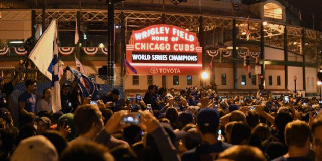 Nov 2, 2016; Chicago, IL, USA;  Chicago Cubs fans celebrate after game seven of the 2016 World Series against the Cleveland Indians outside of Wrigley Field. Cubs won 8-7. Mandatory Credit: Patrick Gorski-USA TODAY Sports