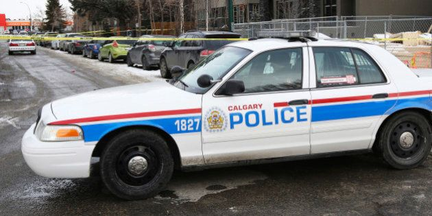 Calgary Police cars block off a street were seven people were shot in a New Year's house party in the...