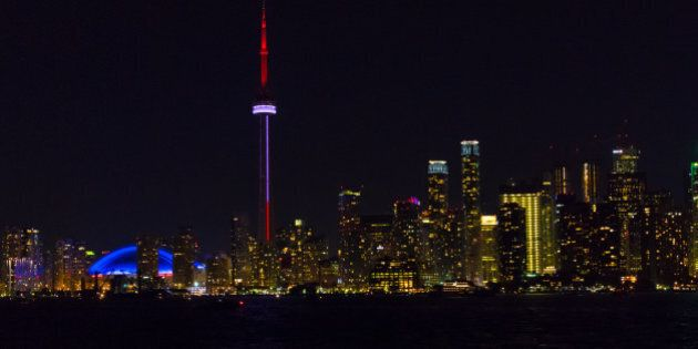 TORONTO, ONTARIO, CANADA - 2016/07/01: Night view of the Toronto skyline from inside the waters of Lake...