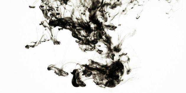 Studio Shot of Black Oil in Water on White Background